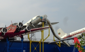More planes outside.  Note the DC-3 with the slide exit to the museum floor inside--nothing like safety measures!