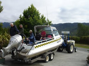Abel Tasmin Aqua Taxi being towed, passengers and all into the parking lot about a mile from the water