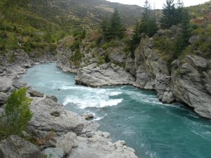 Kawarau River, Roaring Meg segment, with a sledger in the water