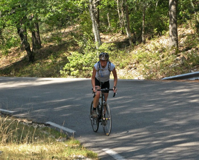 Becky, out of the saddle in a Lance Armstrong imitation on the steep, lower portion of the climb