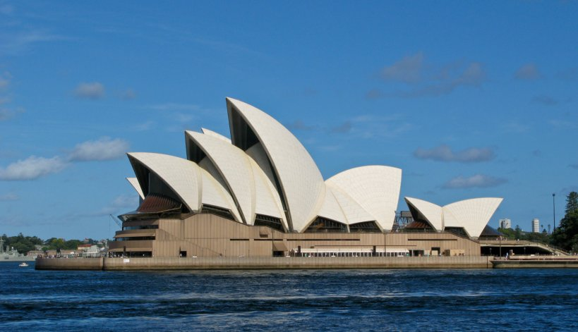 The iconic Opera House in bright sun from the ferry
