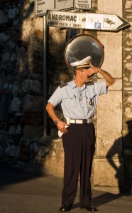 A typically sylish policeman directing the morning traffic in Taormina