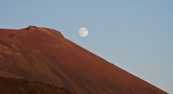 Moonrise over a cinder cone on Mt. Etna