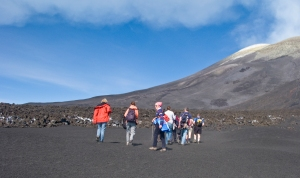 The tour group moves up the volcano