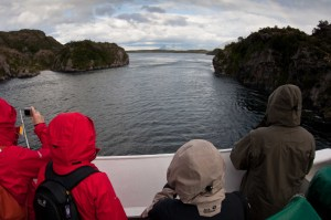 Watching while the Navimag ferry heads towards a narrow channel