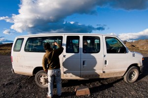 Our driver cleans the windows of our van for our photo outing.