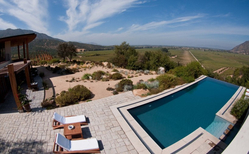 The infinity pool and guest house at Casa Lapostolle