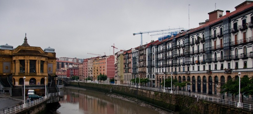 Bilbao's buildings along the Nervión River with Mercado de la Ribera on the left