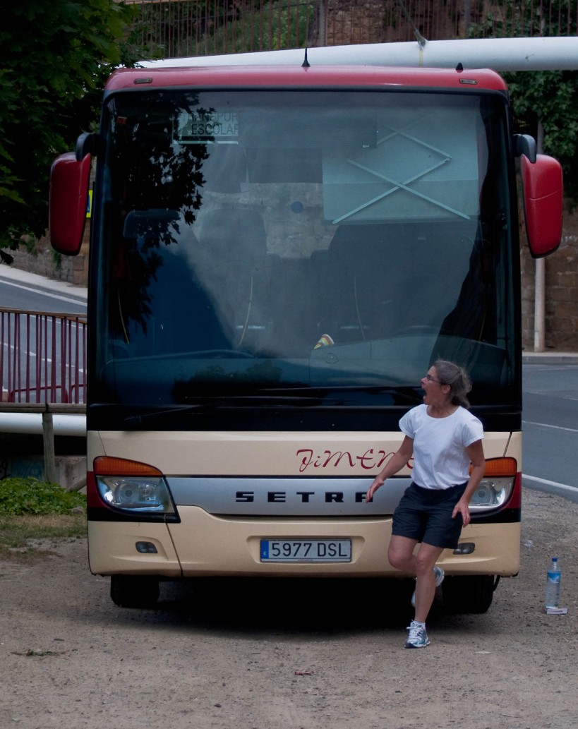 Becky participating in the lesser known Running of the Tour Buses