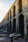 Traffic on modern Atatürk Boulevard heads under the 4th Century Valens Aqueduct