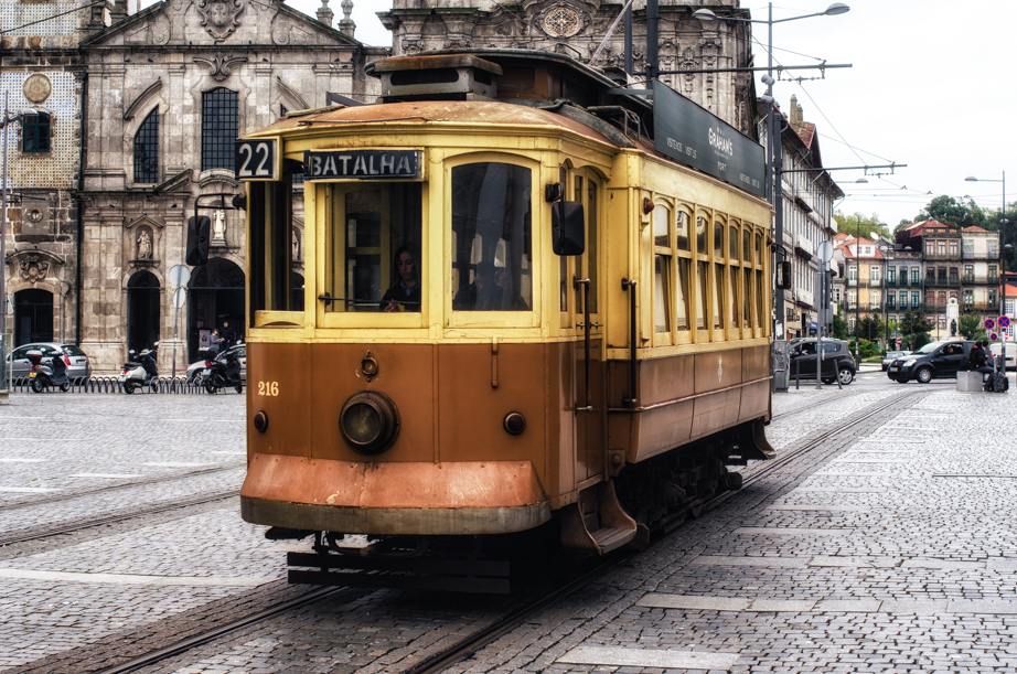 A tram rolls through Porto's streets