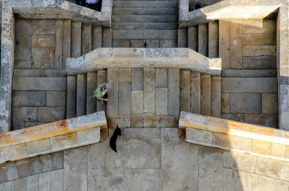 Becky and Gigi climb the steps to the Tower of Hercules