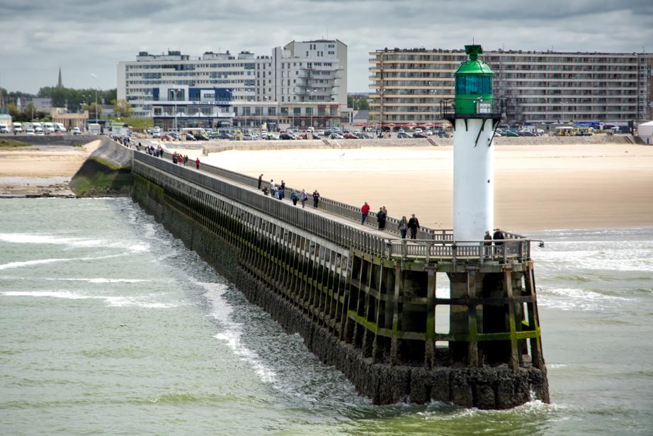 A pier marks the entrance to Calais' harbor