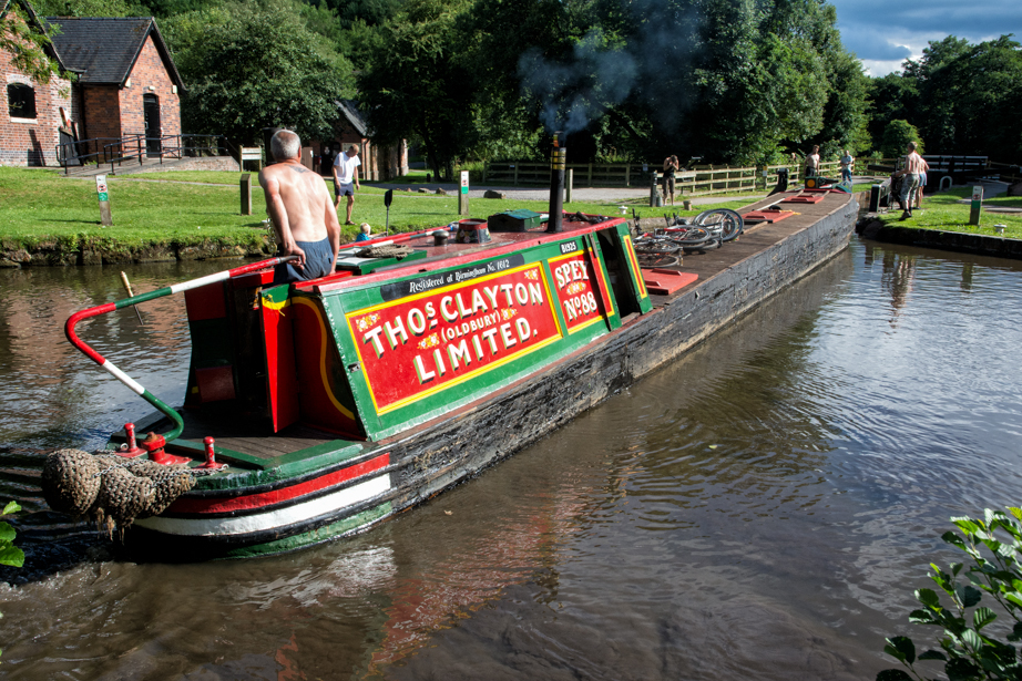 A narrowboat moves into the last lock on the Caldon Branch.