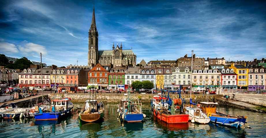 St Colman's Cathedral towers over Cobh's harbor.