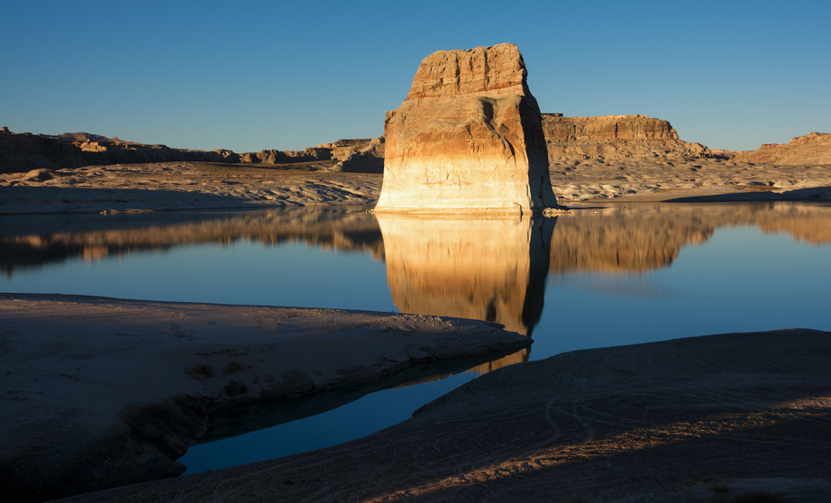Near Wahweap Marina on the border of Utah and Arizona, Lone Rock, an island in Lake Powell, is seemingly on the verge of becoming part of the mainland.