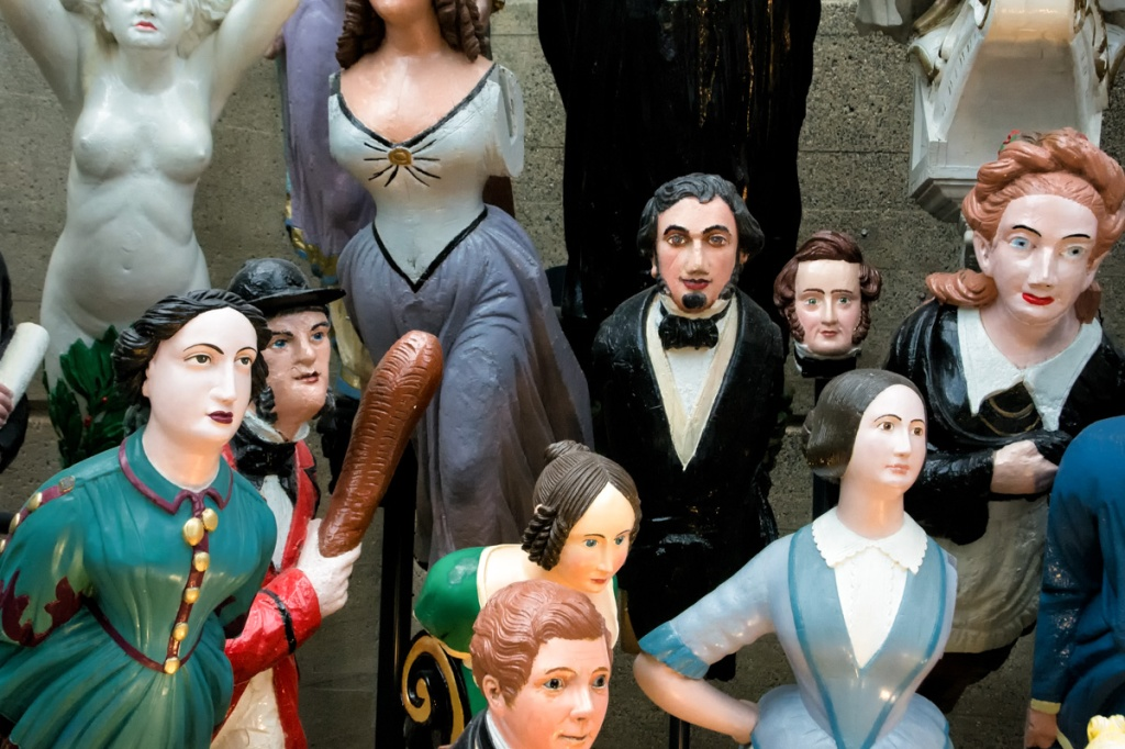 Figureheads on display below the Cutty Sark