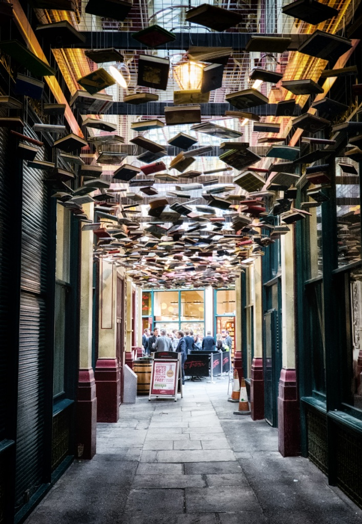 An alley of suspended books