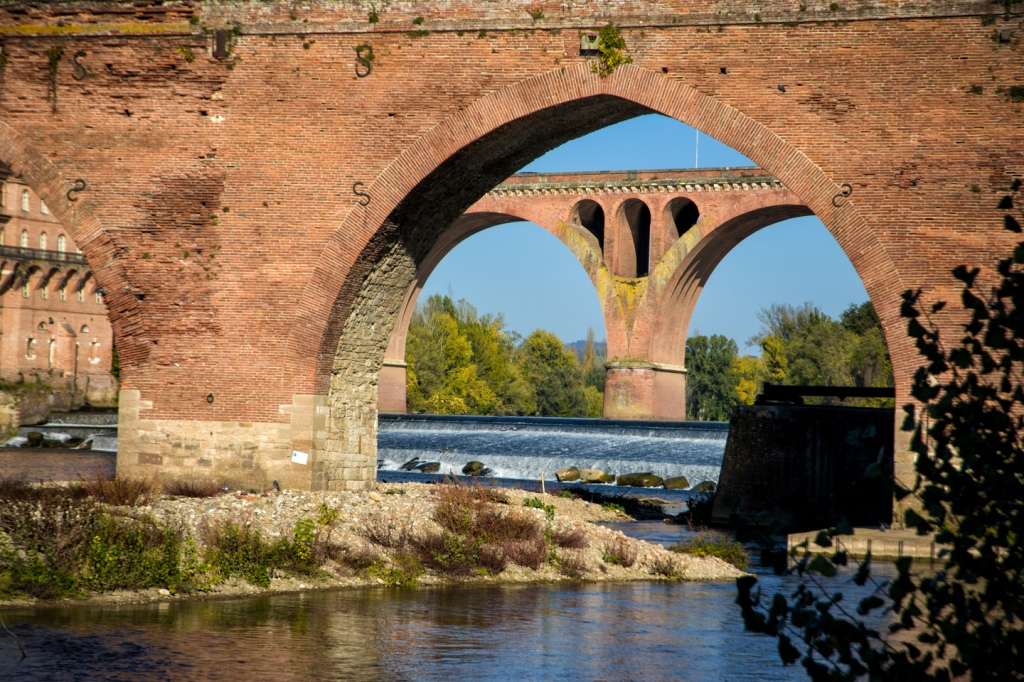 Looking through an arch of the Pont Vieux, the oldest continuously used bridge in France.