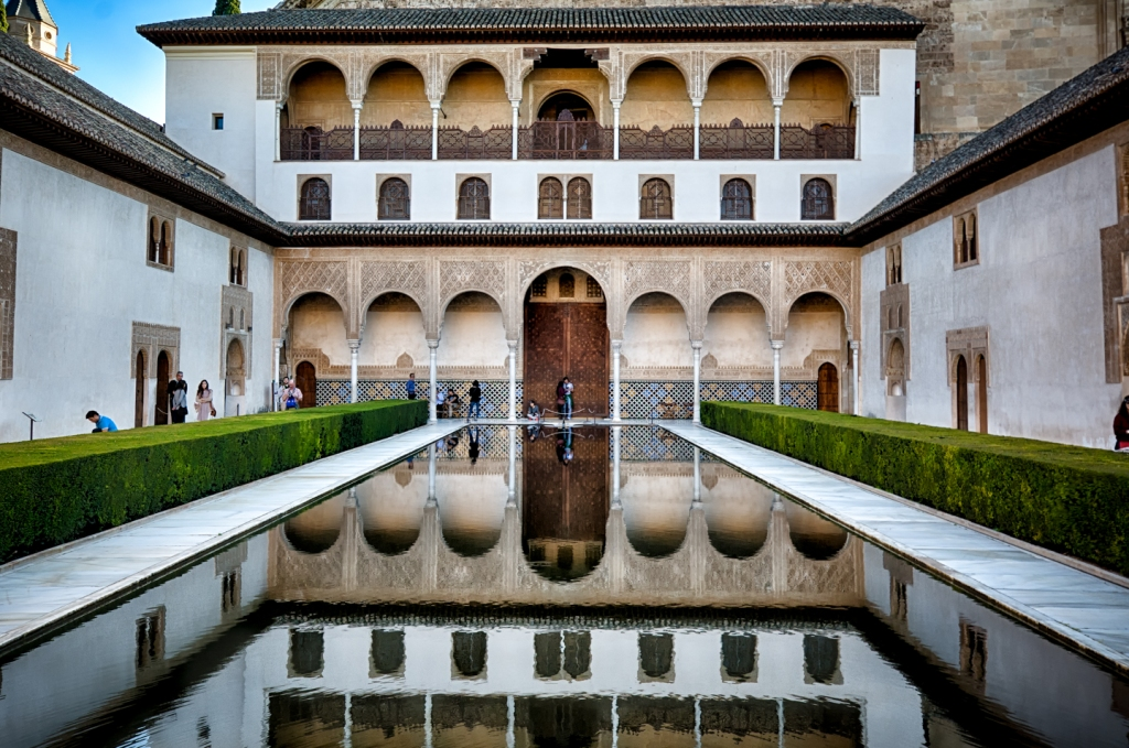 Still water reflects inside the Alhambra.