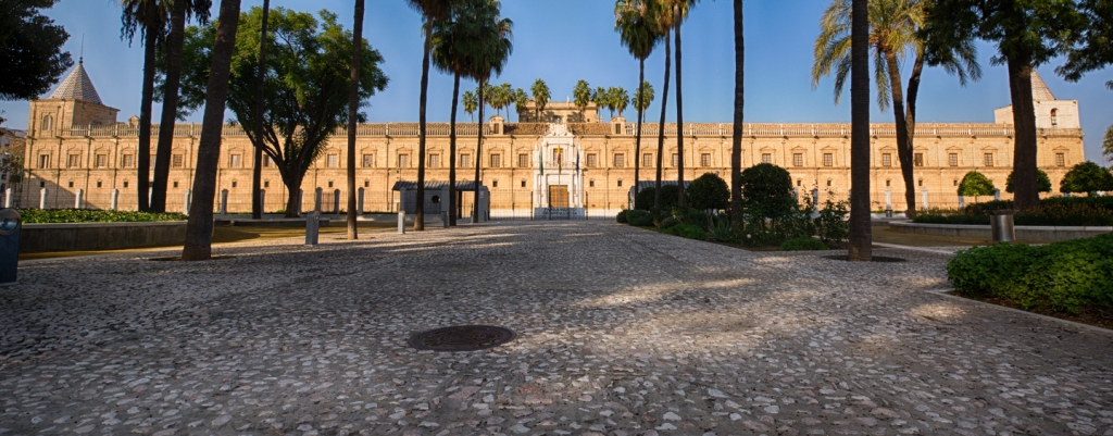 Near a bus stop is Hospital de las Cinco Llagas, the current seat of the Parliament of Andalusia.