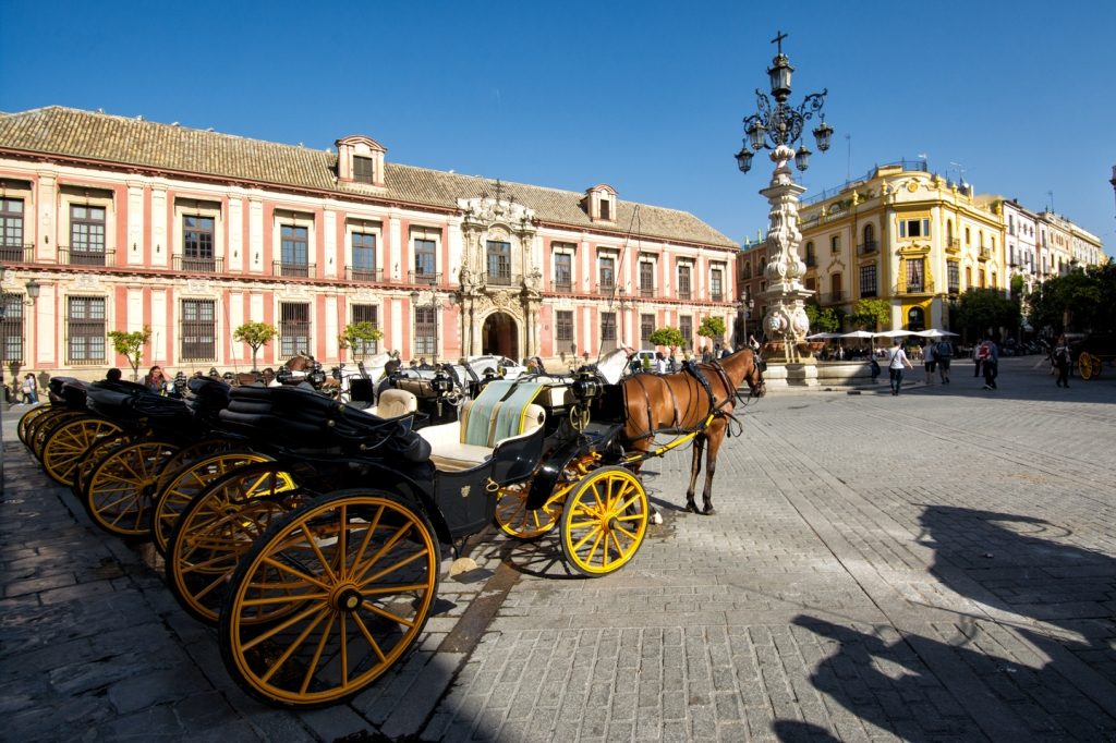Carriages wait for tourists outside of Seville's cathedral.