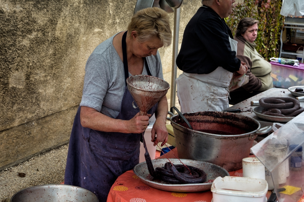 Making blood sausage at the market in Chablis France