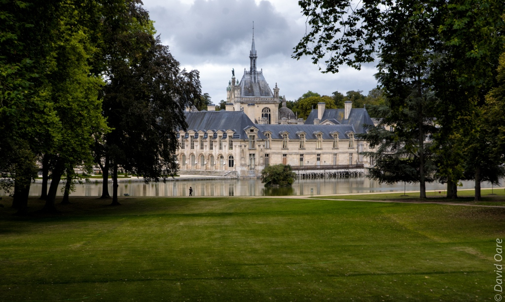 Chantilly's château appears through the trees.